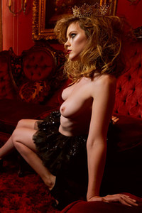 Model Ora Young in Red Room